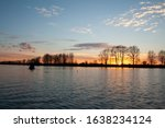 Silhouette Of A Fisherman In A ...