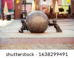 Two Dwarfs Pushing Granite Ball ...