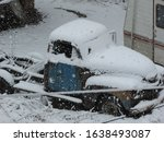 Antique Truck Covered With Snow