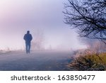 A Person Walk Into The Misty...