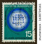 Small photo of Germany stamp - circa 1964 : a stamp printed in Germany shows Progress in science and technology : 25 years of nuclear fission, Hahn and Strassmann - Cerenkov radiation, reactor in operation.