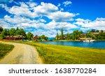 Summer river village road...