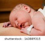 portrait of infant resting on... | Shutterstock . vector #163889315