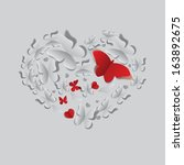 heart made of grey and red cut... | Shutterstock . vector #163892675