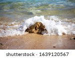 A Sea Wave Hits A Stone On The...