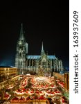 Small photo of Cologne Christmas Market at night with Cathedral in the back.