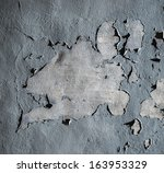 Wall with cracked blue paint - stock photo