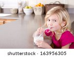 child drinking glass of milk... | Shutterstock . vector #163956305
