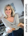 50 year old woman at home... | Shutterstock . vector #163959941