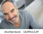 portrait of handsome mature man | Shutterstock . vector #163961129