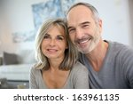 cheerful senior couple enjoying ... | Shutterstock . vector #163961135