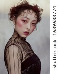 Small photo of Ruthless Asian woman in black costume