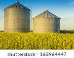 A Pair Of Steel Grain Bins Sit...