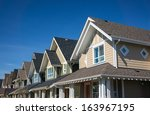 Row Of Modern Townhouses In...