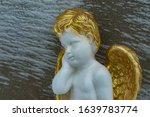 Angel With Golden Hair And Wings