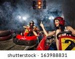 girl is driving go kart with... | Shutterstock . vector #163988831