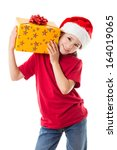 Smiling girl in Santa hat with yellow gift box in hands, isolated on white - stock photo