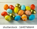 easter colored eggs lie on a... | Shutterstock . vector #1640768644