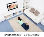 portrait of young woman lying... | Shutterstock . vector #164104859