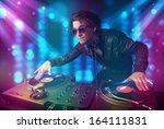 young dj mixing music in a club ... | Shutterstock . vector #164111831