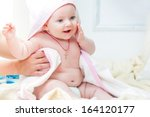 small baby girl is sitting on... | Shutterstock . vector #164120177