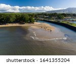 Aerial shot of the river anahulu leading to the twin arched road bridge in the North Shore town of Haleiwa