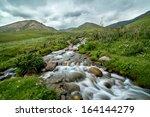 mountain brook in blurred...   Shutterstock . vector #164144279