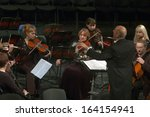 Small photo of DNEPROPETROVSK, UKRAINE - NOVEMBER 23: Members of the Symphonic Orchestra of the State Opera and Ballet Theatre perform ADAGIO on November 23, 2013 in Dnepropetrovsk, Ukraine