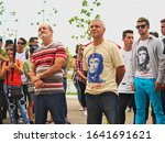 Small photo of Santa Clara, Villa Clara / Cuba - May 10, 2017: Workers of UCLV (University) attending a political act in support of the cuban Revolution. This type of acts are very common in Cuba