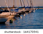 Sailboats Rest Peacefully At...