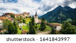 Scenic panoramic view of old medieval town of historic Gruyeres, home to the famous Le Gruyere cheese on a beautiful sunny day with clouds in summer, canton of Fribourg, Switzerland