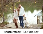 young happy couple walking with ... | Shutterstock . vector #164186429