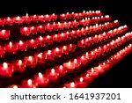 Group Of Red Candles In Church...