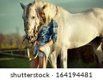 Portrait of young beautiful woman and horse - stock photo
