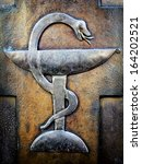 Small photo of Aesculapian staff - Caduceus at a historic gravestone