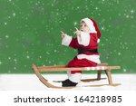 Little Toddler In Santa Claus...