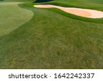 Green Golf Firm And Sand Hole