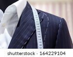 suits on shop mannequins | Shutterstock . vector #164229104
