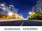 light trails on the street at... | Shutterstock . vector #164230061