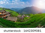 Panoramic View of Seven Stars Accompany the Moon cascading layered Rice Terraces forming part of Longji Rice Terraces, Pingan village, northern Guilin, Guangxi Province, China