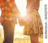 young couple in love walking in ... | Shutterstock . vector #164237075