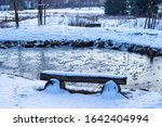 A Wooden Bench Covered With A...