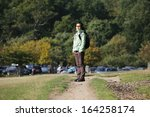 Stock photo east asian woman hiking in the richmond park london uk 164258174