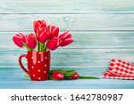 Seven Red Tulips Bouquet In A...