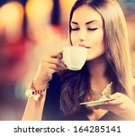 coffee. beautiful girl drinking ... | Shutterstock . vector #164285141