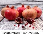 Fresh Pomegranate On Wooden...