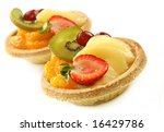 Small custard and glazed fruit tarts, isolated on white. - stock photo