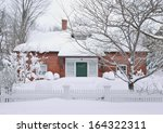 Suburban House Covered In Snow