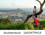 Small photo of Honolulu, HI - 25 january 2020: Tourists pose for photos at Tantalus Overlook with Waikiki and Diamond Head in background