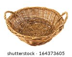 Brown wicker basket isolated over white background - stock photo